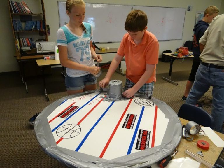 A picture of kids building with duct tape.