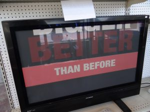 The second TV showing an ad.