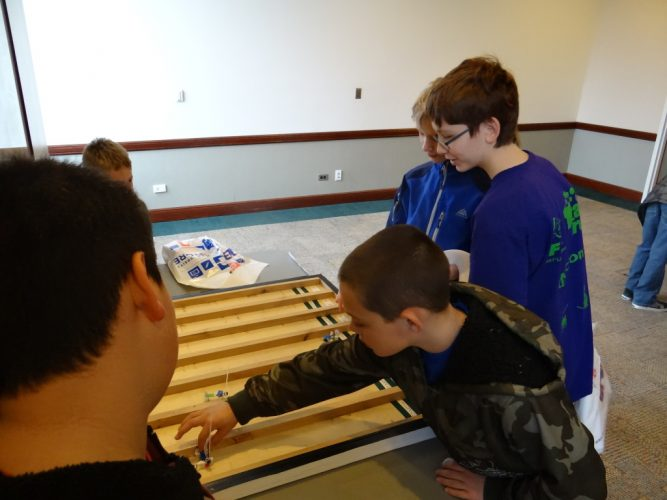 A picture of kids building their own games.